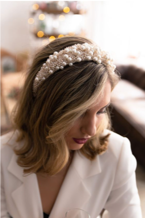lady wearing a pearl headband