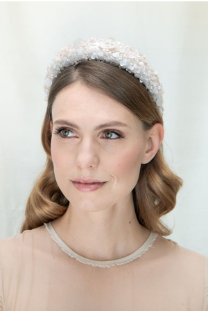 a bride wearing a pearl headband