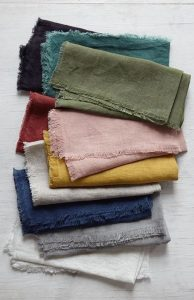 a stack of napkins in different colours