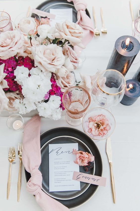 table with a pink bouquet of flowers