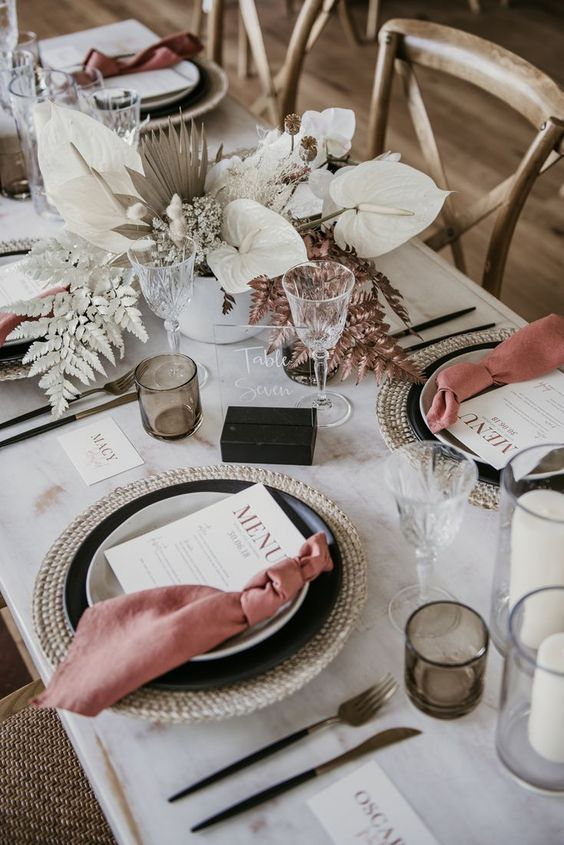 table with plates and napkins