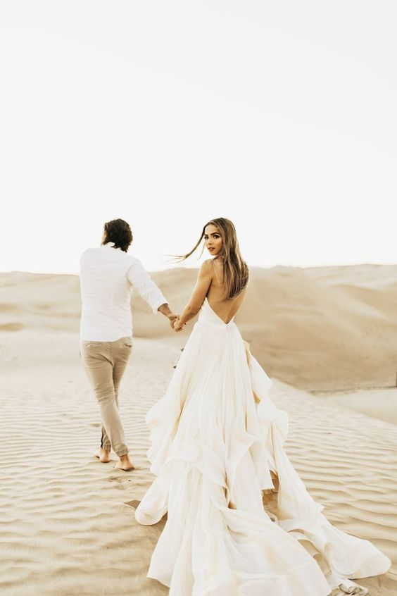 bride and groom in desert