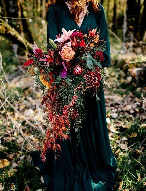 girl in velvet dress holding colorful bouquet