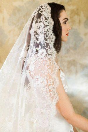 brunette bride wearing a lace mantilla veil