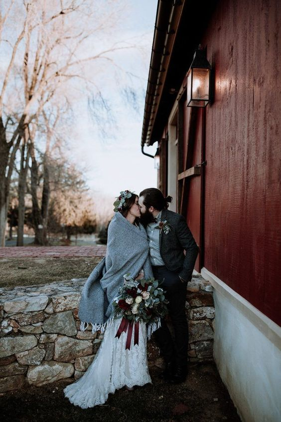 couple kissing winter wedding