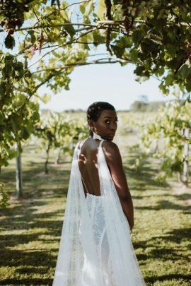 Bride looking over her shoulder with statement dress