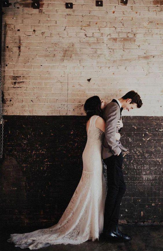 bride hugging groom from behind