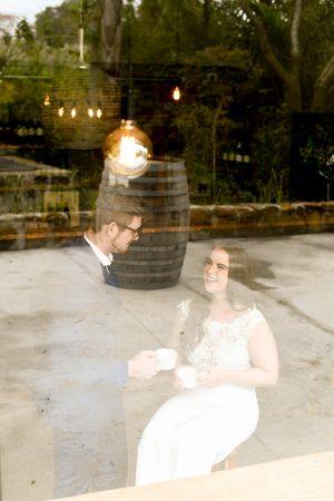brunette bride looking into groom's eyes