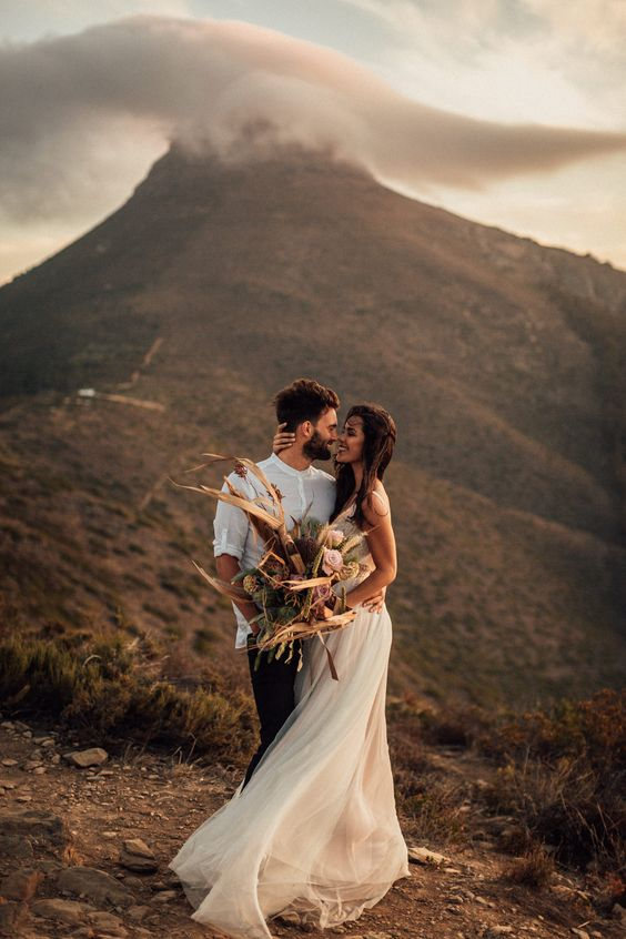 bridal couple on mountain top