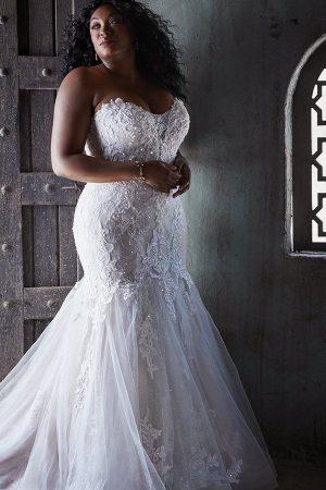 bride in maggie sottero dress looking over shoulder