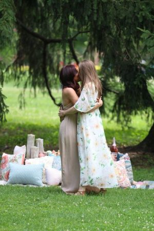 Lesbian couple kissing after proposal