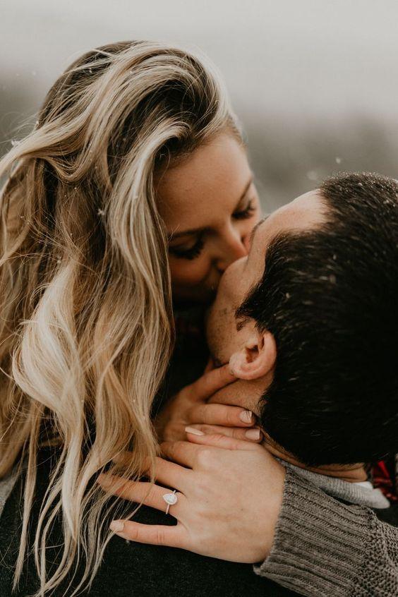 lady kissing her fiancé