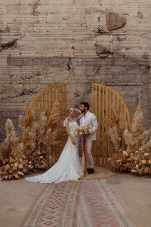 bridal couple holding bouquet