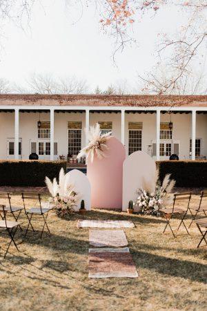 pink colour block ceremony backdrop